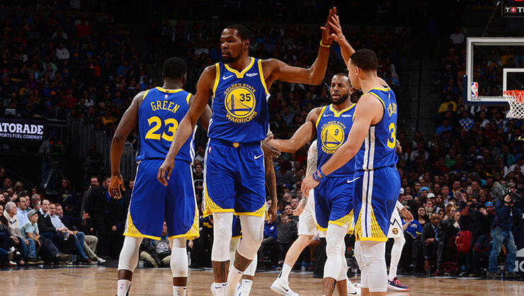 Kevin Durant #35 hi-fives Stephen Curry #30 of the Golden State Warriors