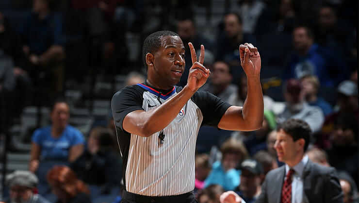 Referee official Sean Wright makes a call during the game between the New Orleans Pelicans and Minnesota Timberwolves