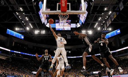 Wisconsin Sports - Marquette rallies, defeats Providence 79-68 on Dwyane Wade Day