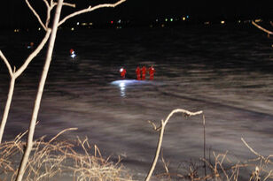 Search in dark for car through ice in Storm Lake PHOTOS