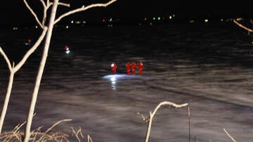 Local News - Search in dark for car through ice in Storm Lake PHOTOS
