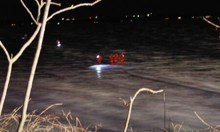 WHO Radio News - Search in dark for car through ice in Storm Lake PHOTOS