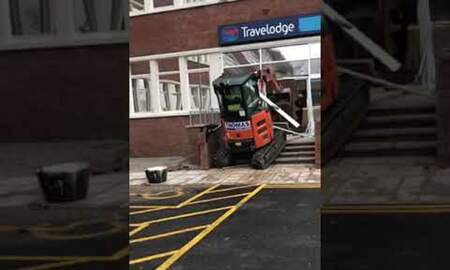 Weird News - Police in England Hunting For Man Who Smashed Up Travelodge Using Digger