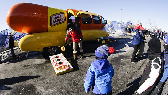 Child throws beanbag near Oscar Mayer Weinermobile prior to the New York Rangers and Buffalo Sabres Winter Classic NHL game