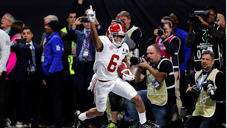 DeVonta Smith #6 of the Alabama Crimson Tide celebrates catching a 41 yard touchdown pass to beat the Georgia Bulldogs in the CFP National Championship presented by AT&T in overtime at Mercedes-Benz Stadium on January 8, 2018 in Atlanta, Georgia