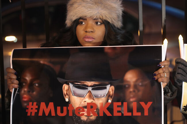 Protestors Rally In Support Of Sex Abuse Survivors At R Kelly's Chicago Studios CHICAGO, ILLINOIS - JANUARY 09: Demonstrators gather near the studio of singer R. Kelly to call for a boycott of his music after allegations of sexual abuse against young girls were raised on the highly-rated Lifetime mini-series 'Surviving R. Kelly' on January 09, 2019 in Chicago, Illinois. Prosecutors in Illinois and Georgia have opened investigations into allegations made against the singer, whose real name is Robert Sylvester Kelly. (Photo by Scott Olson/Getty Images)