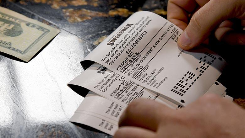 A bettor places wagers on some of the more than 400 proposition bets on the Super Bowl