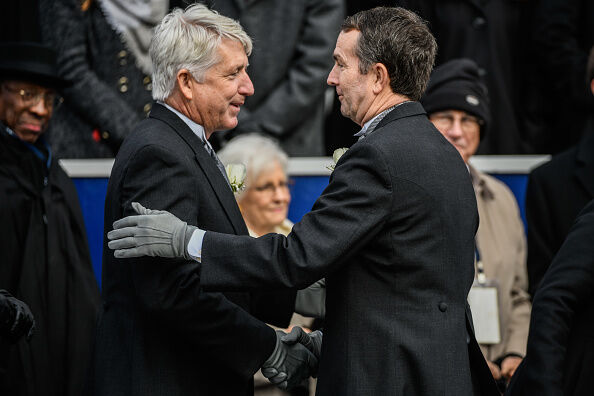 RICHMOND, VA - JANUARY 13: Gov. Elect Ralph Northam greets Attorney Elect General Mark Herring as he makes his way to the inaugural platform before taking the oath of the office on Saturday, January 13, 2018, at the Virginia State Capitol in Richmond, VA. (Photo by Salwan Georges/The Washington Post via Getty Images)