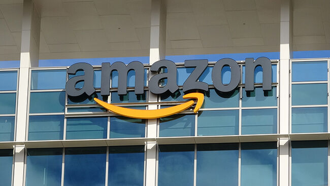 Close-up of sign with logo on facade of the regional headquarters of ecommerce company Amazon in the Silicon Valley town of Sunnyvale, California