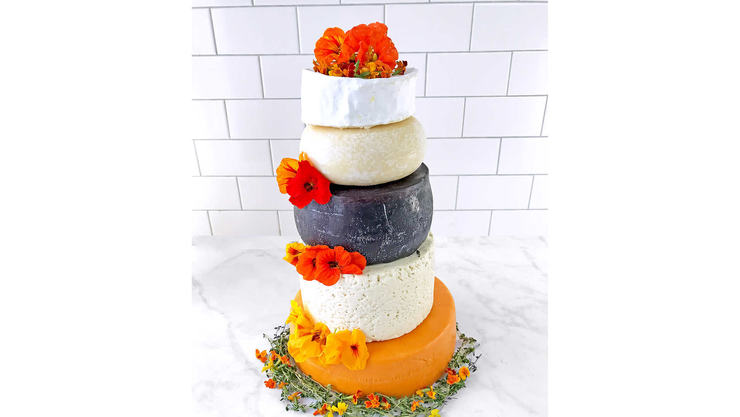 "costco selling 24-pound ""wedding cake"" made out of five different cheeses"