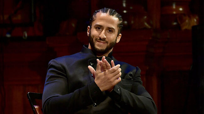 Colin Kaepernick on stage at the W.E.B. Du Bois Medal Award Ceremony at Harvard University
