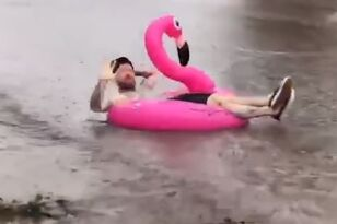 Dude Floats Down Flooded SoCal Street