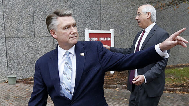 Republican Mark Harris, left, and his attorney David Freedman leave after speaking with the media following a meeting with state election investigators