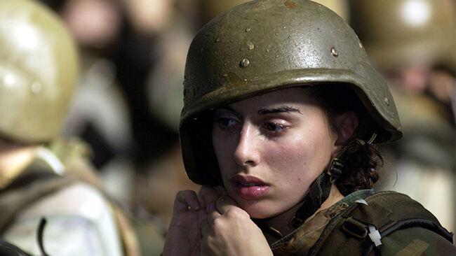 United States Marine Corps female recruit Stephanie Palladino adjusts her Kevlar helmet