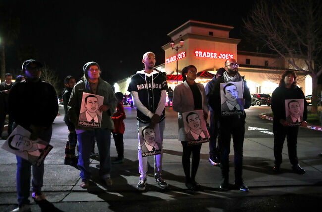 Protesters in Trader Joe's parking lot
