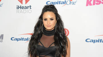 EJ -  Demi Lovato Accidentally Knocks Trainer's Tooth Out