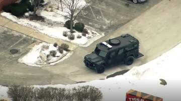 None - BREAKING:  U.S. Marshals task force officer shot at an Illinois hotel