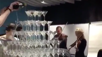 Weird, Odd and Bizarre News - Giant Champagne Glass Pyramid Crashes, Ruins Fancy Event