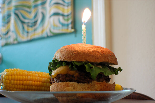 Cheeseburger with one birthday candle