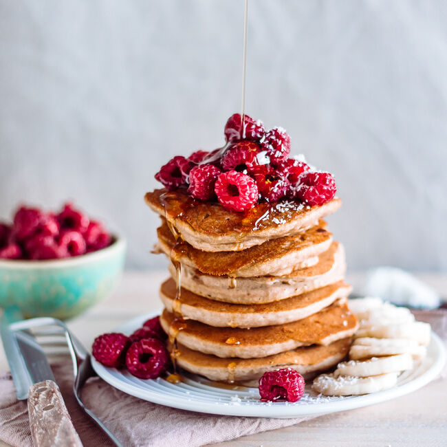 Stack of raspberry and maple syrup pancakes