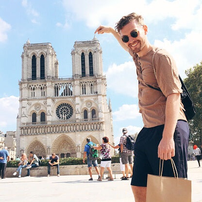 Portrait Of Man Pointing At Notre Dame