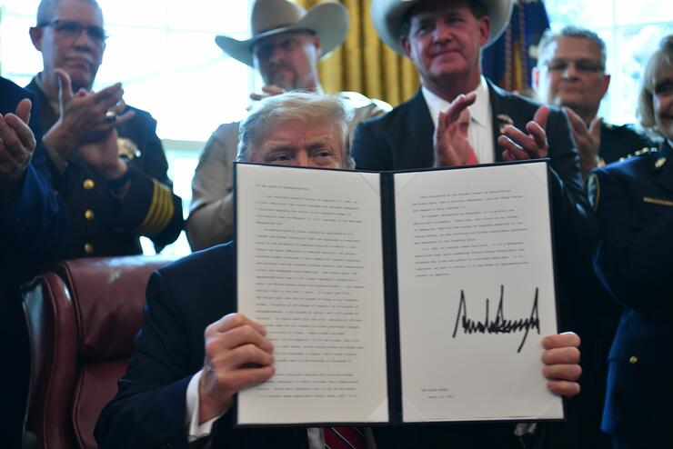 President trump signs first veto of presidency