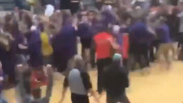 Sports Top Stories - Playoff Basketball Game Ends With Fans From Both Teams Storming The Court