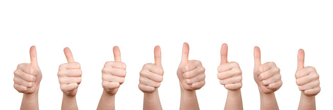 Panoramic View Of Cropped Hands Showing Thumbs Up Sign Against White Background