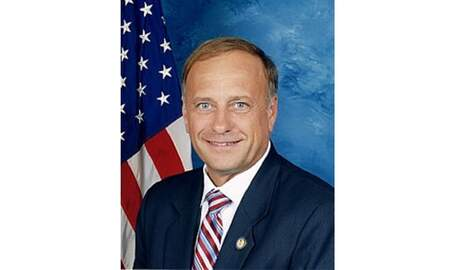 None - Man arrested for tossing water on Iowa Congressman Steve King