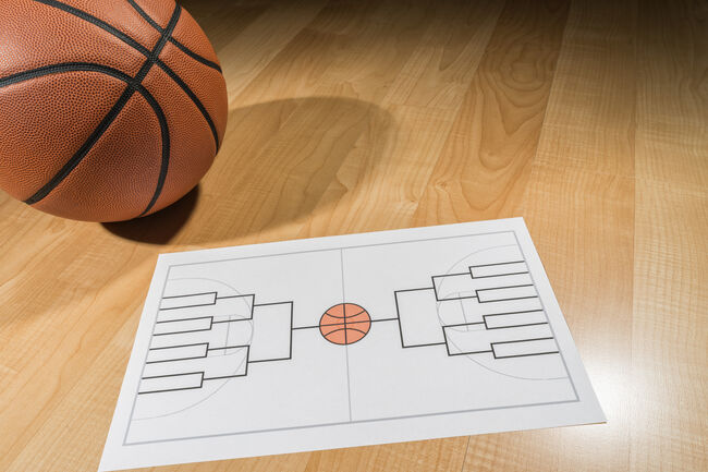Blank college basketball tournament bracket on paper