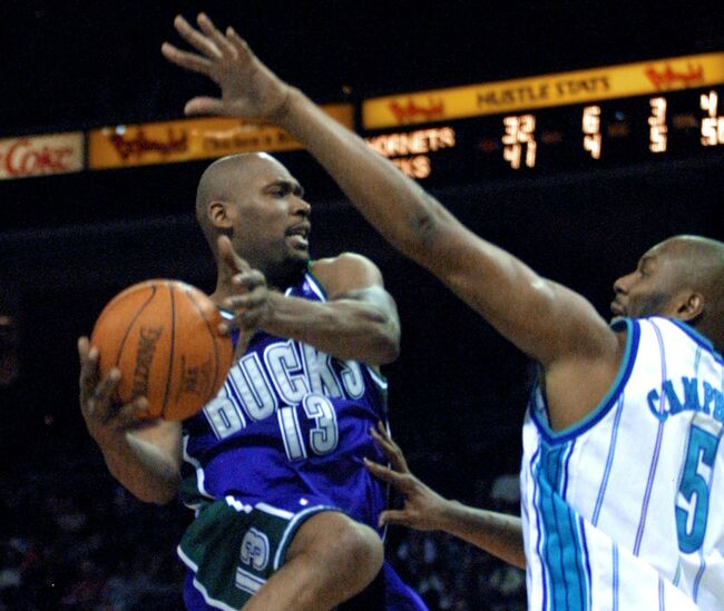 Milwaukee Bucks forward Glenn Robinson (L) drives