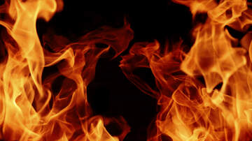 Rochester News - Garage Fire in Charlotte Threatens House Nearby