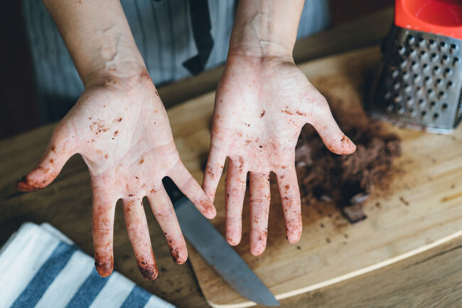 Dirty hands with chocolate