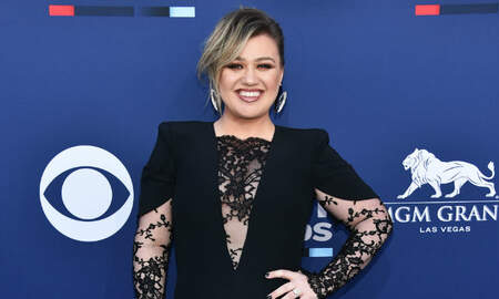 image for Kelly Clarkson Says She Looks Like She Had A Boob Job In New 'Voice' Photo