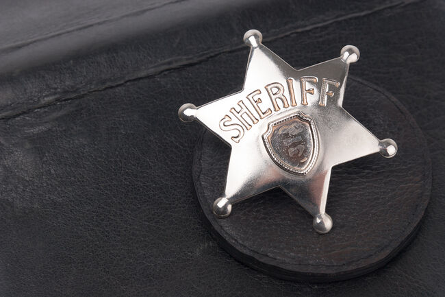 Sheriff's badge on dark background