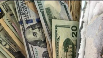 BC - Woman Discovers 'Trash' Blowing Along Road Is Actually Cash...Lots Of It