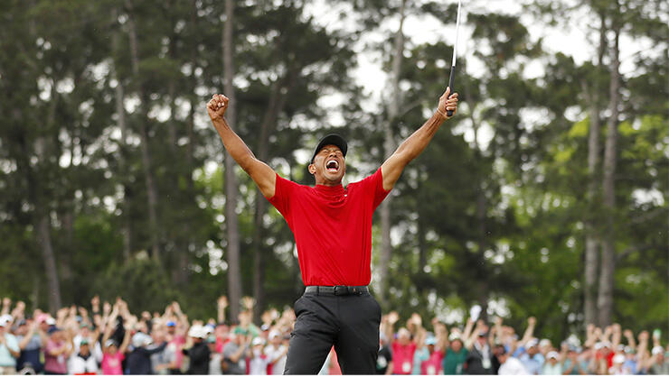 Tiger Woods of the United States celebrates after sinking his putt on the 18th green to win during the final round of the Masters at Augusta National Golf Club on April 14, 2019