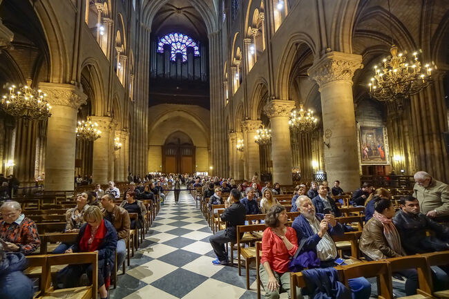 Tourists visiting the Notre Dame de Paris on september 25, 2013 in Paris. The cathedral of Notre Dame is one of the top tourist destinations in Paris