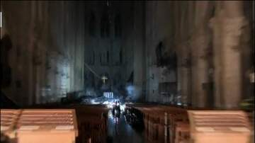 The Insider - Altar cross one of many images from inside fire-torn Notre Dame cathedral