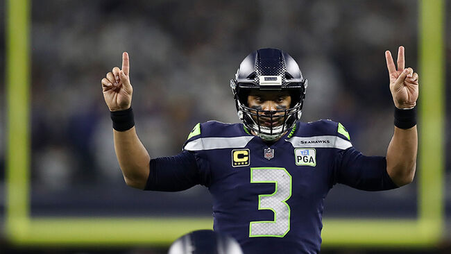 Russell Wilson #3 of the Seattle Seahawks gestures before a play in the third quarter against the Dallas Cowboys during the Wild Card Round at AT&T Stadium