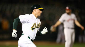 Sports Desk - A's End Astros' 10-Game Winning Streak