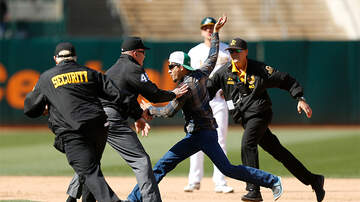 Sports Top Stories - Umpire Tackles Fan Who Ran Onto The Field During Oakland A's Game