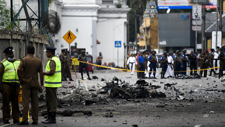 Sri Lankan security personnel inspect the debris of a car after it explodes when police tried to defuse a bomb near St. Anthony's Shrine in Colombo on April 22, 2019, a day after the series of bomb blasts targeting churches and luxury hotels in Sri Lanka.