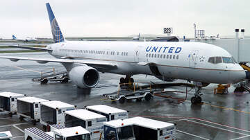 National News - United Airlines Employee Accused Of Directing Racial Slurs At Passenger