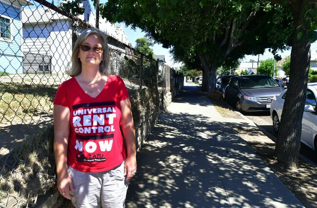 Community activist Elizabeth Blaney is interviewed in front of the apartment block where, with no rent control due to the year it was built, the landlord has increased some rentals by as much as $800, August 3, 2017 in the Boyle Heights neighborhood of Los Angeles, California.