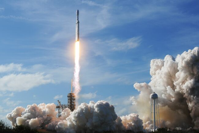 The SpaceX Falcon Heavy launches from Pad 39A at the Kennedy Space Center in Florida, on February 6, 2018, on its demonstration mission. The world's most powerful rocket, SpaceX's Falcon Heavy, blasted off Tuesday on its highly anticipated maiden test flight, carrying CEO Elon Musk's cherry red Tesla roadster to an orbit near Mars. Screams and cheers erupted at Cape Canaveral, Florida as the massive rocket fired its 27 engines and rumbled into the blue sky over the same NASA launchpad that served as a base for the US missions to Moon four decades ago. Photo credit: JIM WATSON/AFP/Getty Images