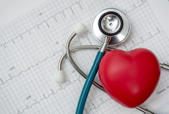 Heart ,stethoscope on cardiogram report of cardiology patient. Cardiologist and medical concept