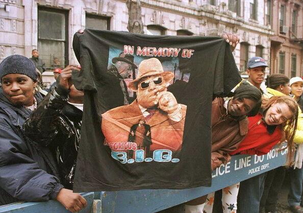 A man displays a T-shirt tribute to rapper Biggie