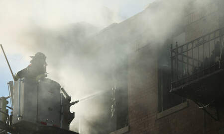 Local News - Fire Erupts at Chinatown Building