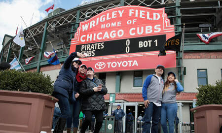 Sports Top Stories - Cubs Ban Fan Who Flashed White Power Gesture Behind Sideline Reporter